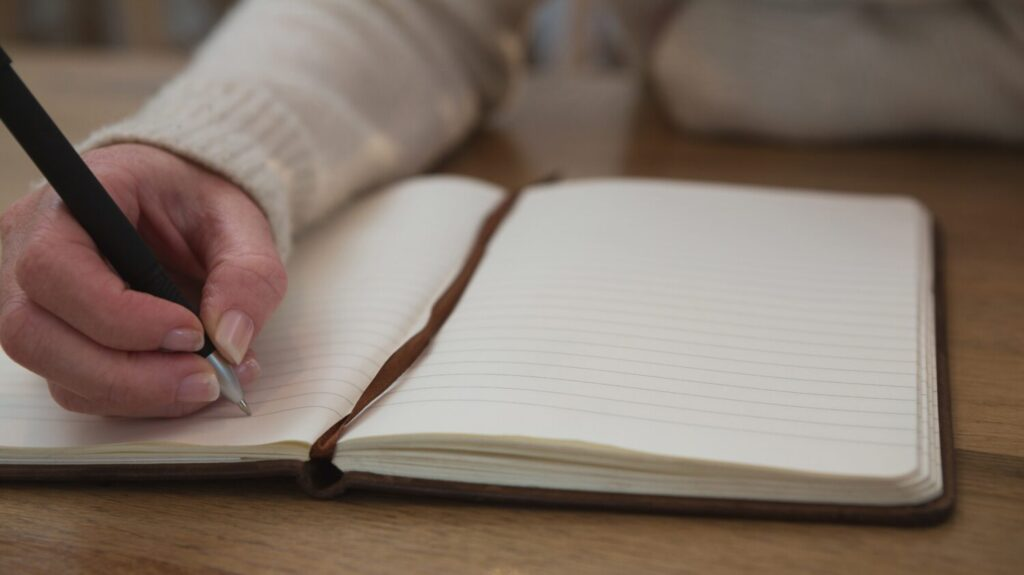hand writing in a notebook